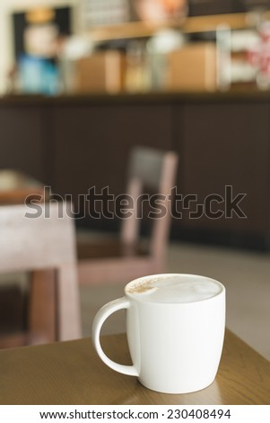 Cup of Coffee on Table inside Coffee Shop