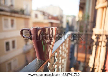 Cup of coffee on the balcony. Relax concept - stock photo