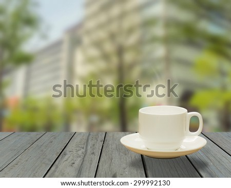 Cup of Coffee on the balcony with modern city view
