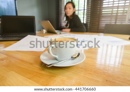 Cup of coffee on the table in the meeting room - stock photo