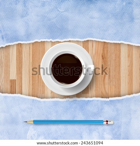 Cup of coffee on wood background with ripped blue paper and blue pencil. Abstract background for template design. - stock photo