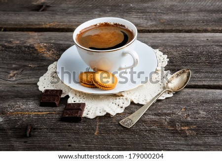 cup of coffee on wood table.