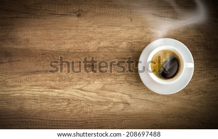 cup of coffee on wooden background with copy space - stock photo