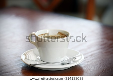 Cup of coffee on wooden table close up