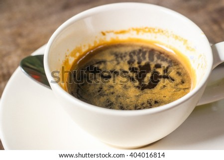 Cup of coffee on wooden table - Espresso coffee - stock photo