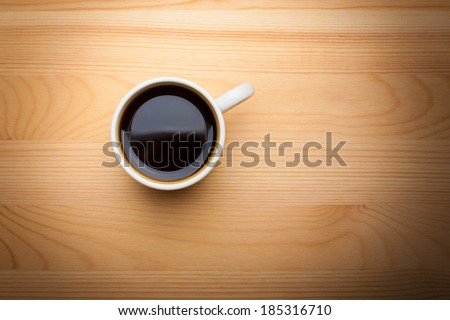 Cup of Coffee on Wooden Tabletop - stock photo