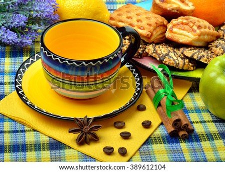 Cup of coffee or tea with dessert served on colored napkin.