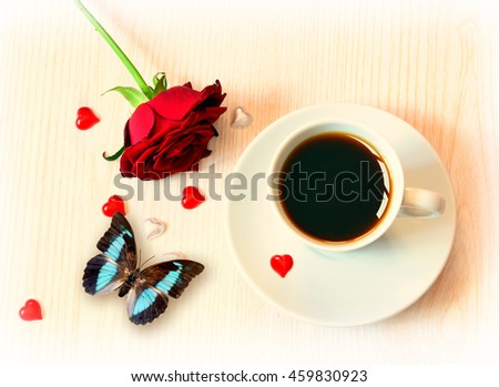 Cup of coffee, red hearts, butterfly and roses for Valentine's Day.
