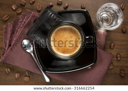 Cup of coffee served Italian-style - stock photo