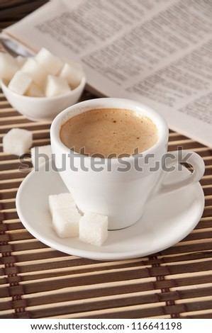 cup of coffee, sugar and newspaper closeup - stock photo