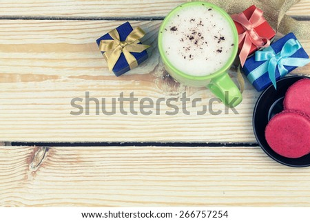 cup of coffee, sweets and gifts with copy space - stock photo