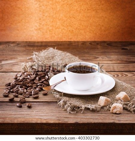 Cup of coffee, sweets and roasted beans. Coffee concept. Selective focus. - stock photo
