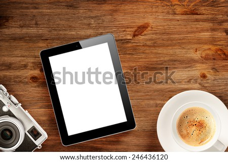 Cup of coffee, tablet pc and classic camera on wooden desk - stock photo