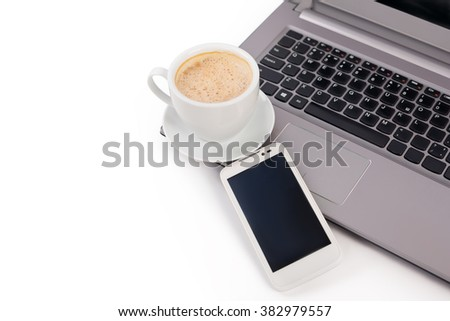 cup of coffee with a laptop and a mobile phone