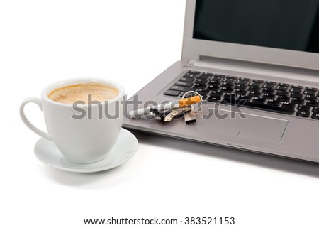 cup of coffee with a laptop and the keys