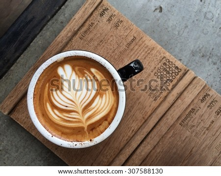 Cup of coffee with beautiful Latte art - stock photo