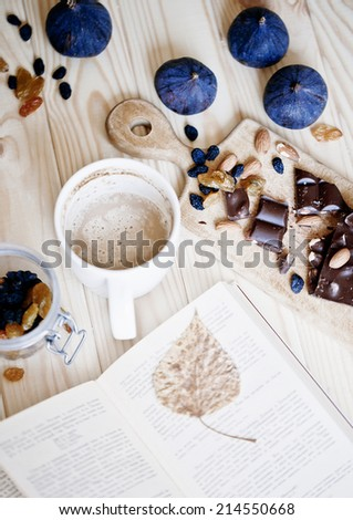 cup of coffee with book and chocolate - stock photo