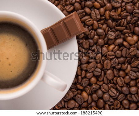 Cup of coffee with chocolate and coffee beans - stock photo