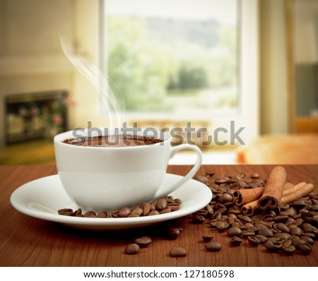 cup of coffee with cinnamon and beans - stock photo