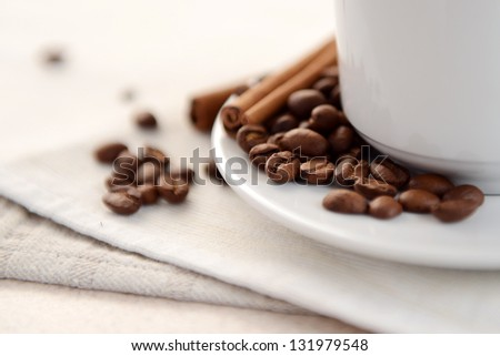 Cup of coffee with cinnamon sticks