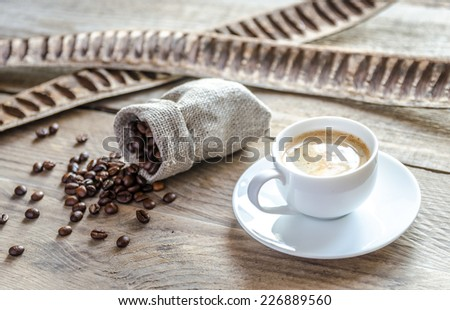 Cup of coffee with coffee beans - stock photo