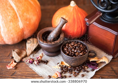 Cup of coffee with coffee beans and coffee grinder. Still life with coffee. - stock photo