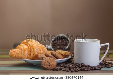Cup of coffee with coffee beans background - stock photo