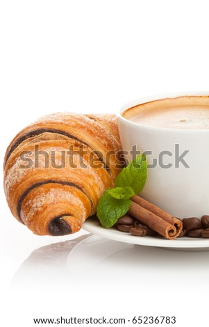 Cup of coffee with coffee beans, cinnamon sticks and chocolate croissant on white background - stock photo