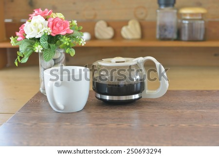 cup of coffee with coffee pot - stock photo