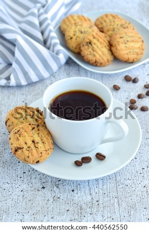 Cup of coffee with cookies