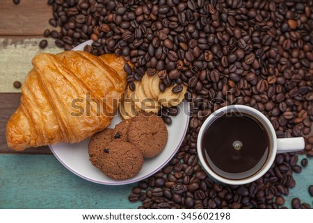 Cup of coffee with cookies and beans - stock photo