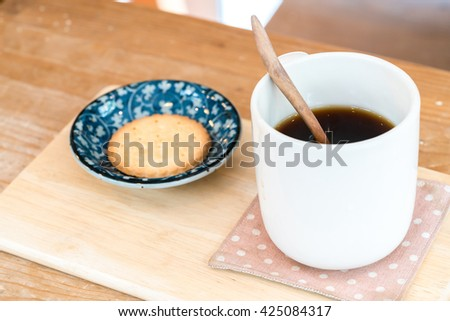 Cup of coffee with crackers.