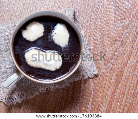 cup of coffee with cream. Coffee cream painted smiley face - stock photo