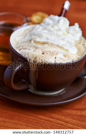 Cup of coffee with cream foam