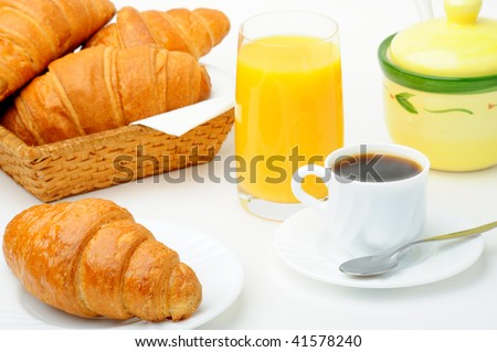 Cup of coffee with croissants and orange juice