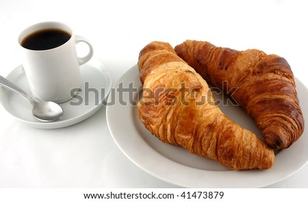 Cup of coffee with croissants isolated in white
