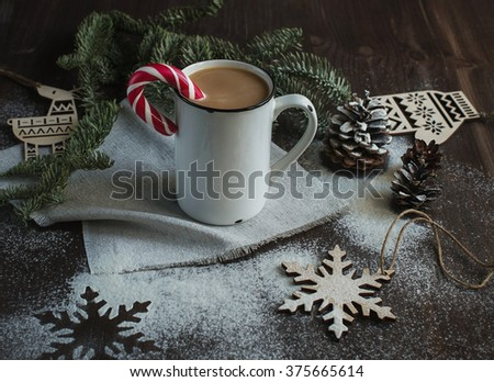 Cup of coffee with decoration on the table - stock photo