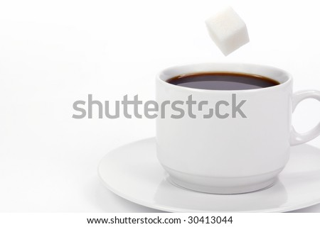 Cup of coffee with falling sugar cube - stock photo