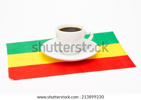 Cup of coffee with flag on white background - stock photo