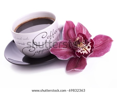 cup of coffee with flower isolated on white