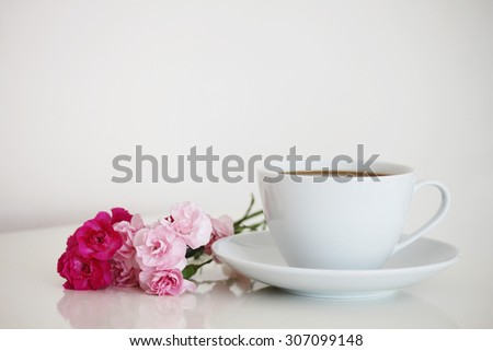 Cup of coffee with flowers - stock photo