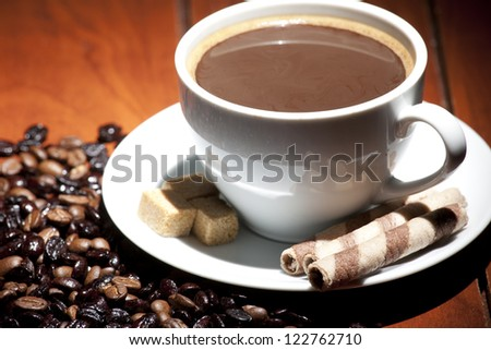 cup of coffee with grains on a dark background