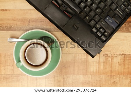 Cup of coffee with laptop