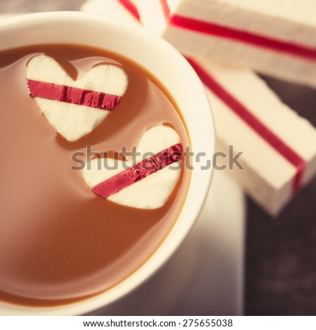 Cup of coffee with marshmallow hearts - stock photo