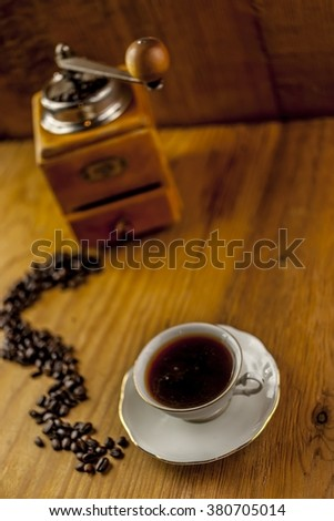 cup of coffee with mill - stock photo