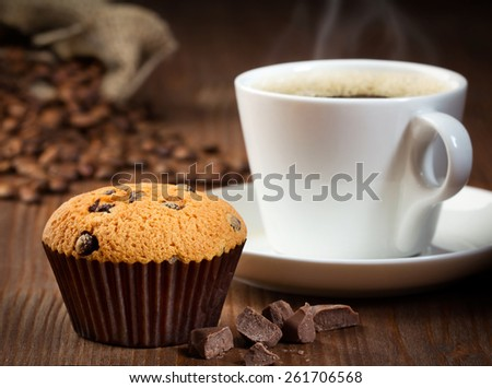 cup of coffee with muffin - stock photo