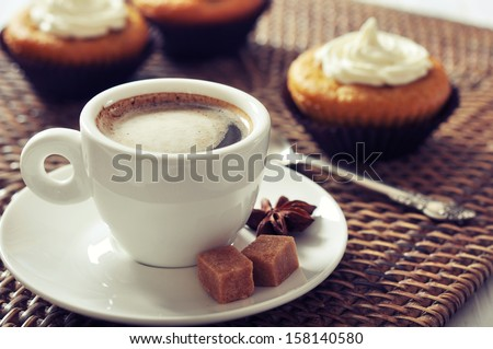 Cup of coffee with muffins on rattan placemat - stock photo