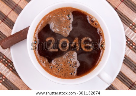 Cup of coffee with New year numbers 2016 on the coffee surface - stock photo