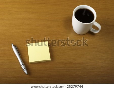 Cup of coffee with Pen and pad on desk - stock photo