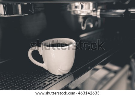 cup of coffee with professional coffee machine vintage color